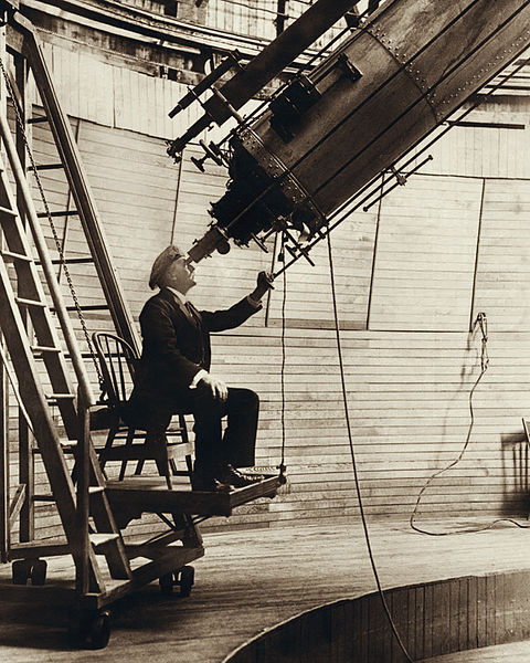 Percival Lowell observing Venus from the observer's chair of Clark telescope at the Lowell Observatory in 1910.